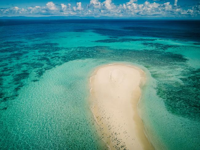 VLASOFF CAY Just off Cairns is the bucket list attraction of Vlasoff Cay – a picturesque sand cay on Vlasoff Reef and the perfect destination for a romantic picnic or to celebrate a special occasion. A short helicopter ride from Cairns will get you there, so you can immerse your soul in the underwater beauty of this stunning spot. Picture: Tourism and Events Queensland/Matt Glastonbury