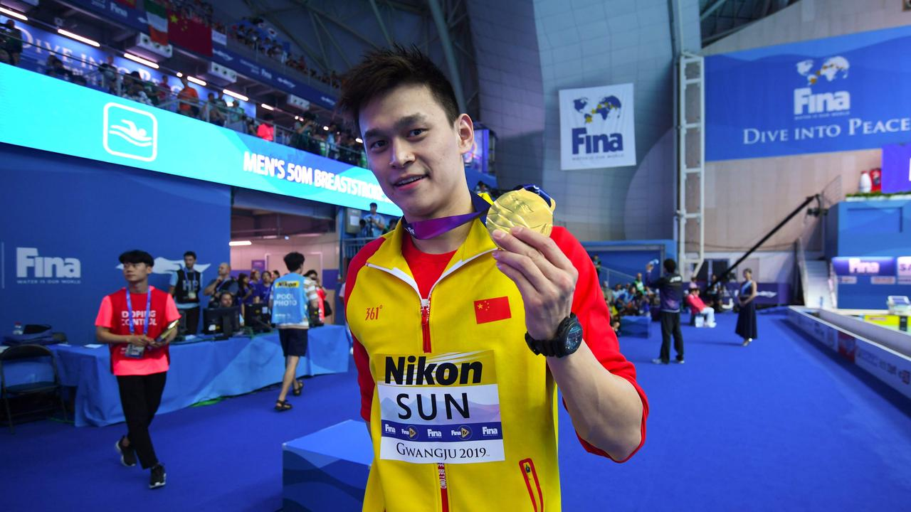 (FChina's Sun Yang poses with his gold medal after the final of the men's 200m freestyle event during the swimming competition at the 2019 World Championships at Nambu University Municipal Aquatics Center in Gwangju, South Korea. AFP