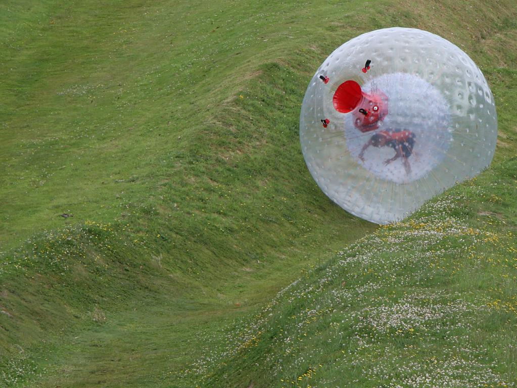 Zorbing — rolling downhill in a giant orb — is an actual thing travel insurance covers.