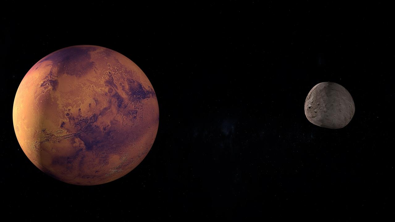 An asteroid sharing the orbit of Mars could be a long-lost piece of the moon, broken off in a cosmic collision.