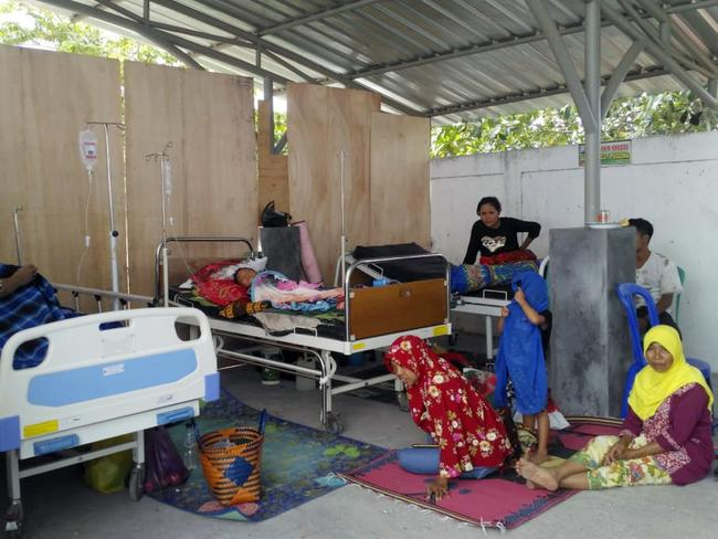Patients are treated outside a hospital following another series of earthquakes in Indonesia. Picture: AP