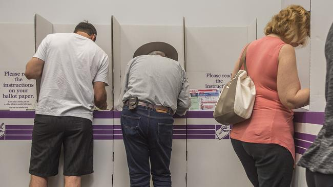 Member for Kennedy Bob Katter fills in his ballot at a polling booth in Edmonton, south of Cairns. PIC: Brian Cassey/AAP
