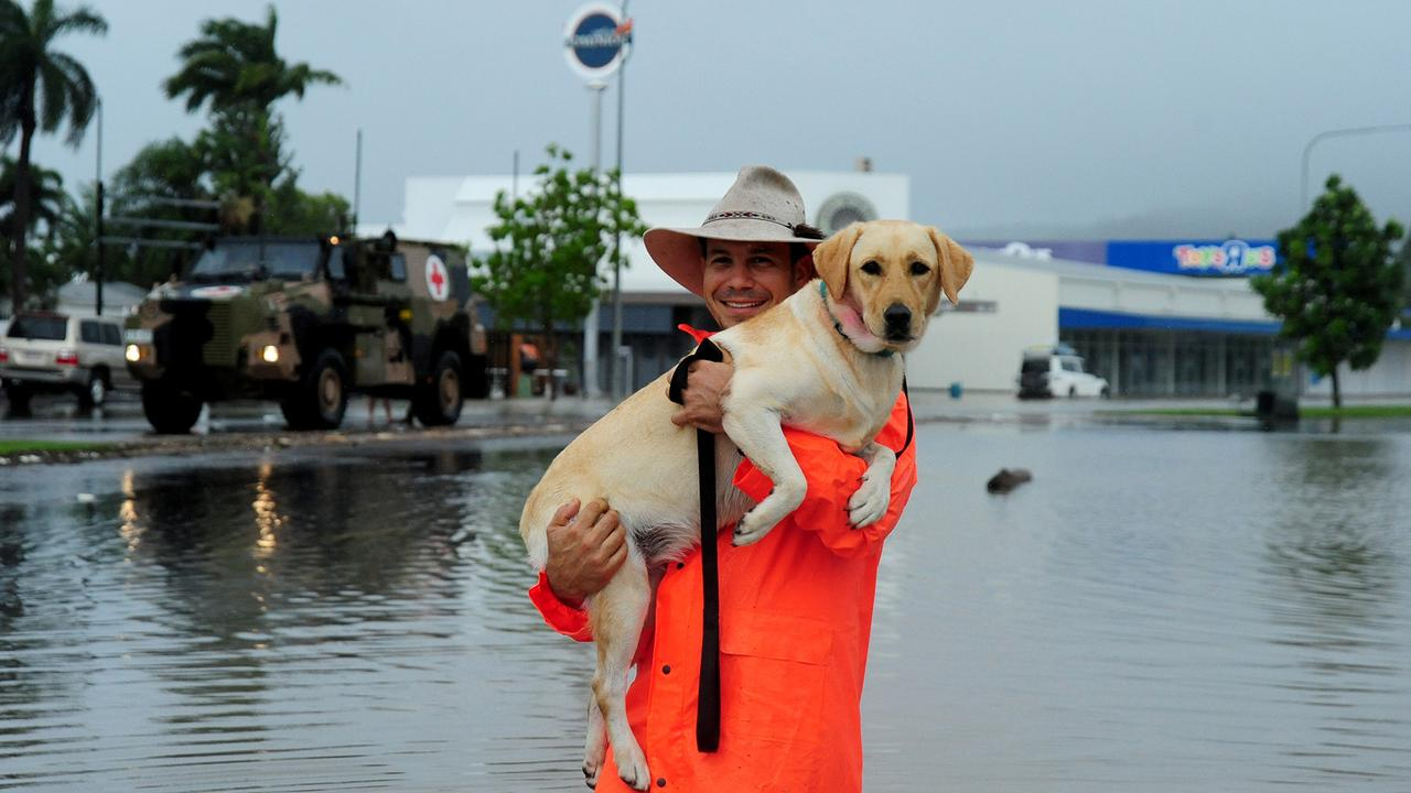 Townsville resident Michael Carperi carried Sunny to safety from his home in the suburb of Hermit Park. Picture: Evan Morgan