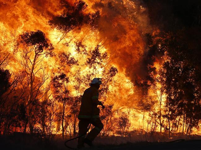 The ferocity of the Salt Ash blaze is evident. Picture: AAP