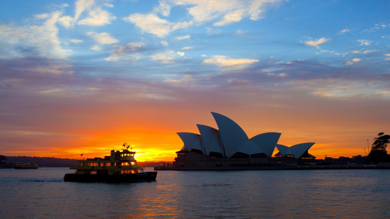 Early morning in Sydney, as a ferry steams across Circular Quay.