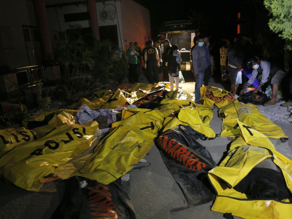 Relatives look for the bodies of their loved ones at a police station in Palu, Central Sulawesi, Indonesia. Picture: AP