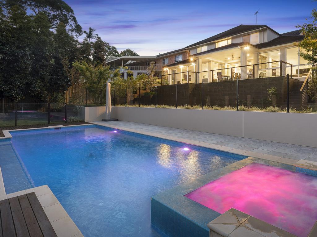 This West Pennant Hills swimming pool is fitted with a coloured lighting system
