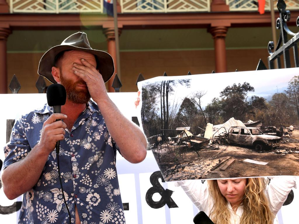 Aaron Crowe speaks to protesters about his home, which was destroyed by bushfires on Friday. Picture: Damian Shaw