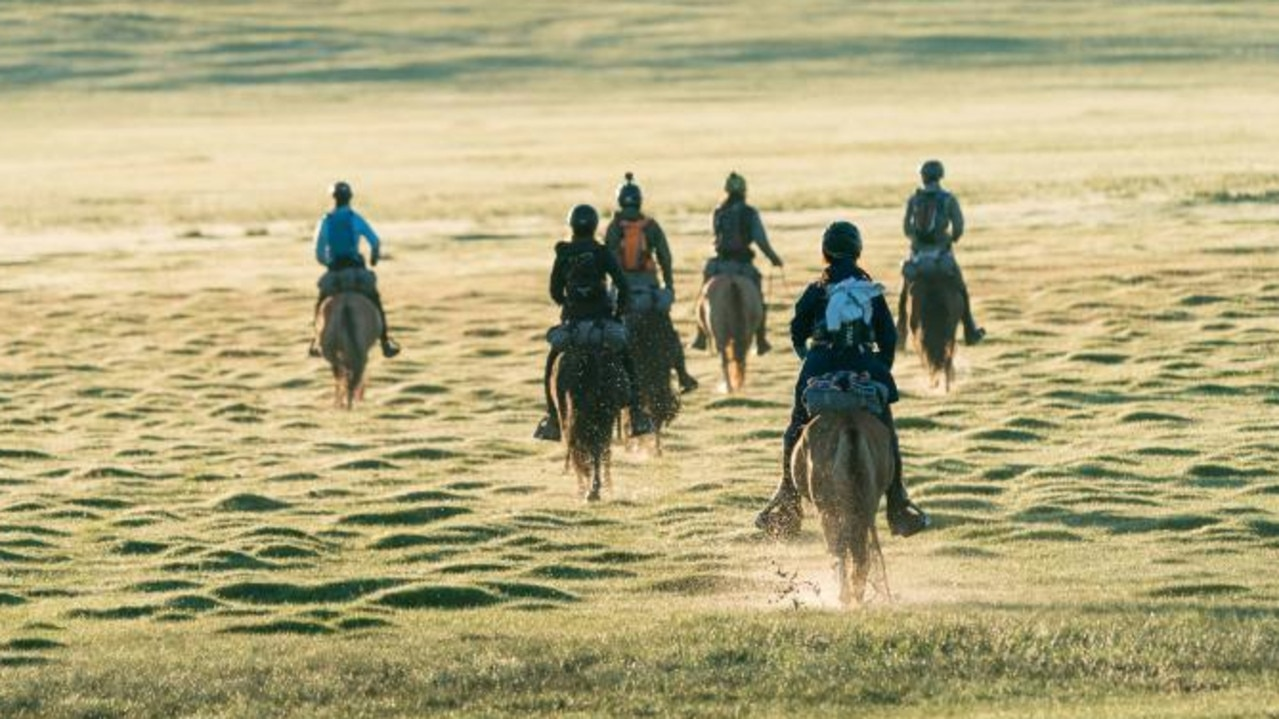 Mongol derby riders 2018 riding across the landscape