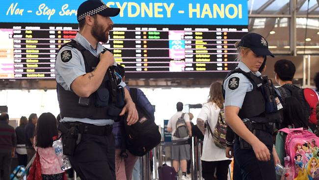 Police patrol Sydney Airport. Picture: AFP PHOTO / WILLIAM WEST