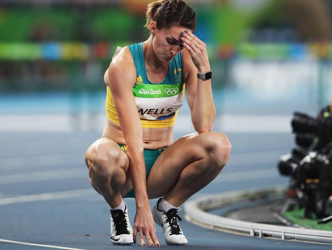 Lauren Wells is overcome after failing to get through the 400m hurdles semi-final. Picture: Phil Hillyard
