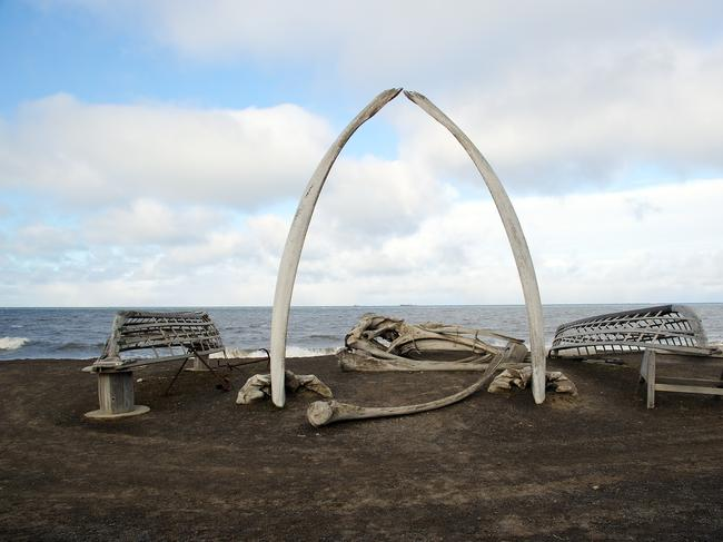 A bowhead whale's jawbone sits on the shore on the outskirts of Utqiagvik, composing an archway looking out to the Chukchi Sea. It symbolises the town's relationship to the sea and whaling.  — Sammy Stewart
