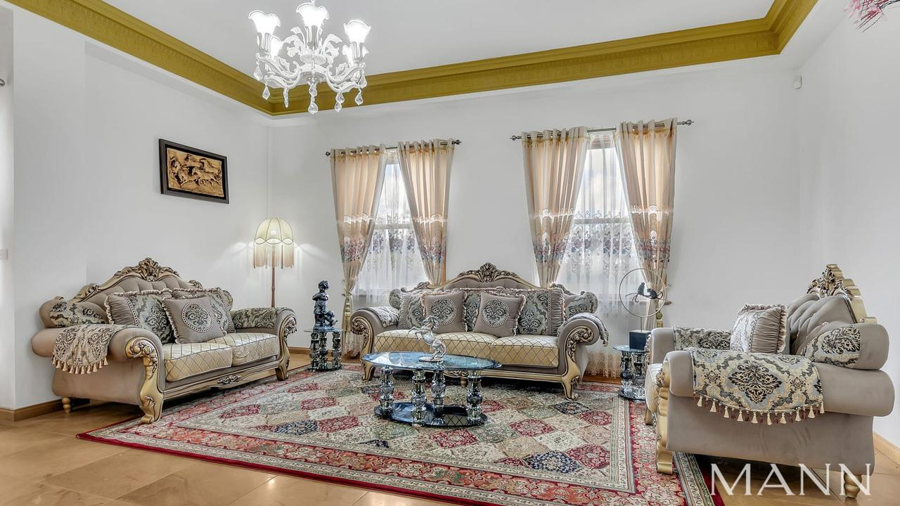 A formal living room at the house.