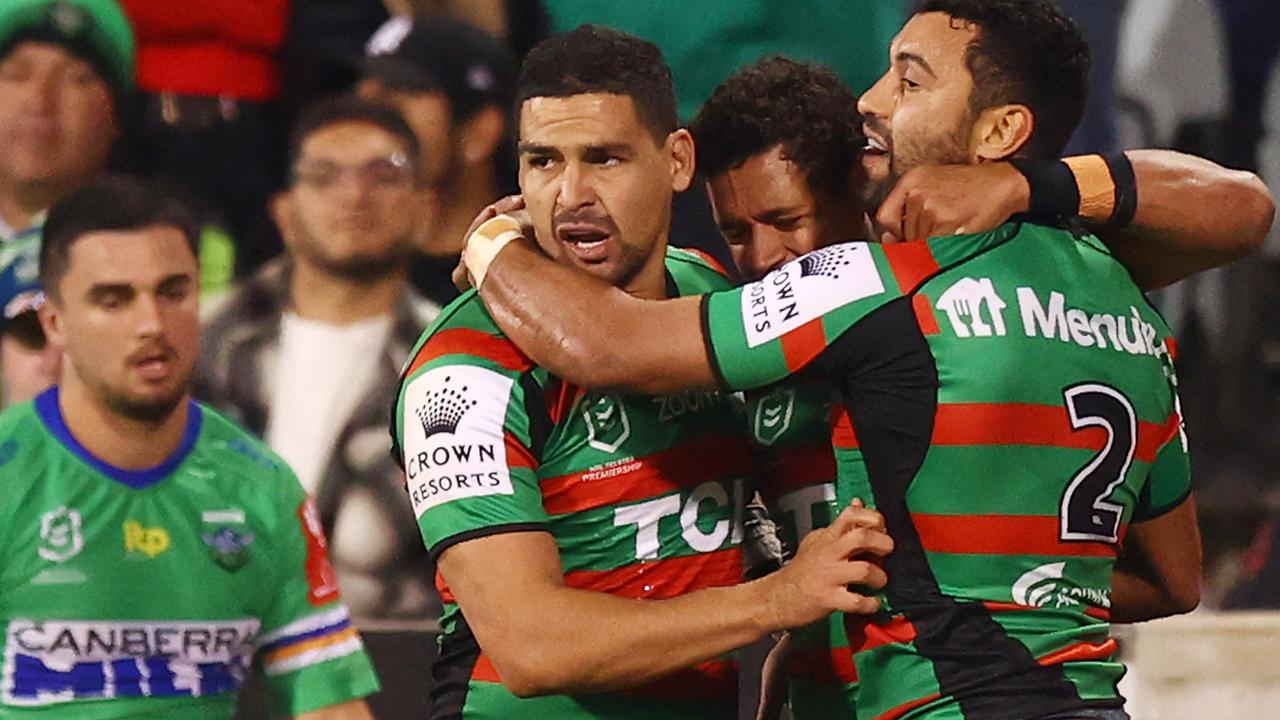 Teammates congratulate Alex Johnston of the Rabbitohs after he scored a try.
