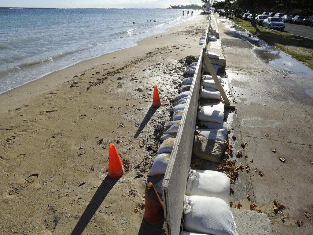 In this June 23, 2017 photo, sand bags line the beach in Honolulu as record high tides hit the islands. Picture: Honolulu Star-Advertiser, Bruce Asato via AP