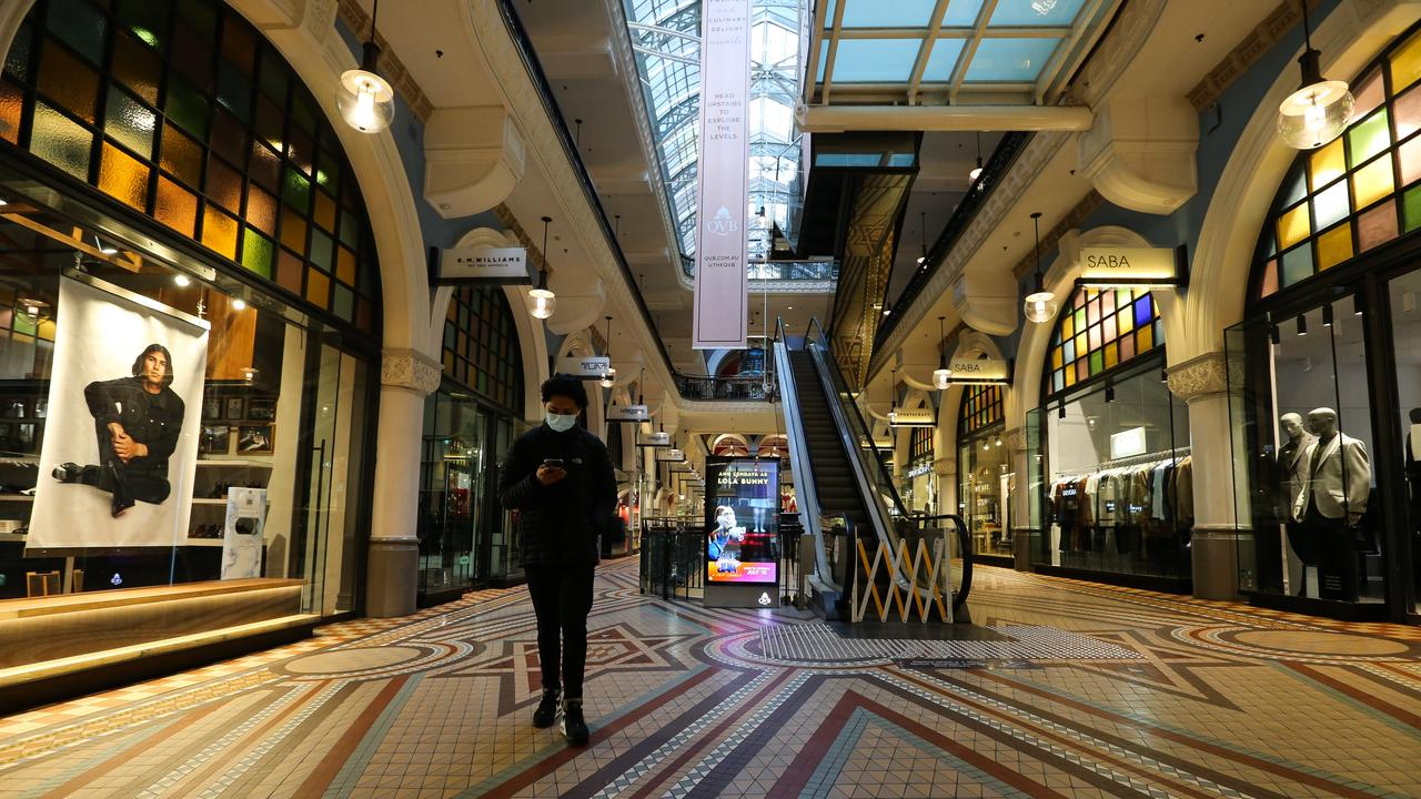 A man walks through a deserted QVB shopping mall normally one of Sydney's busiest malls, as NSW records new Covid cases and deaths. Picture: NCA Newswire /Gaye Gerard