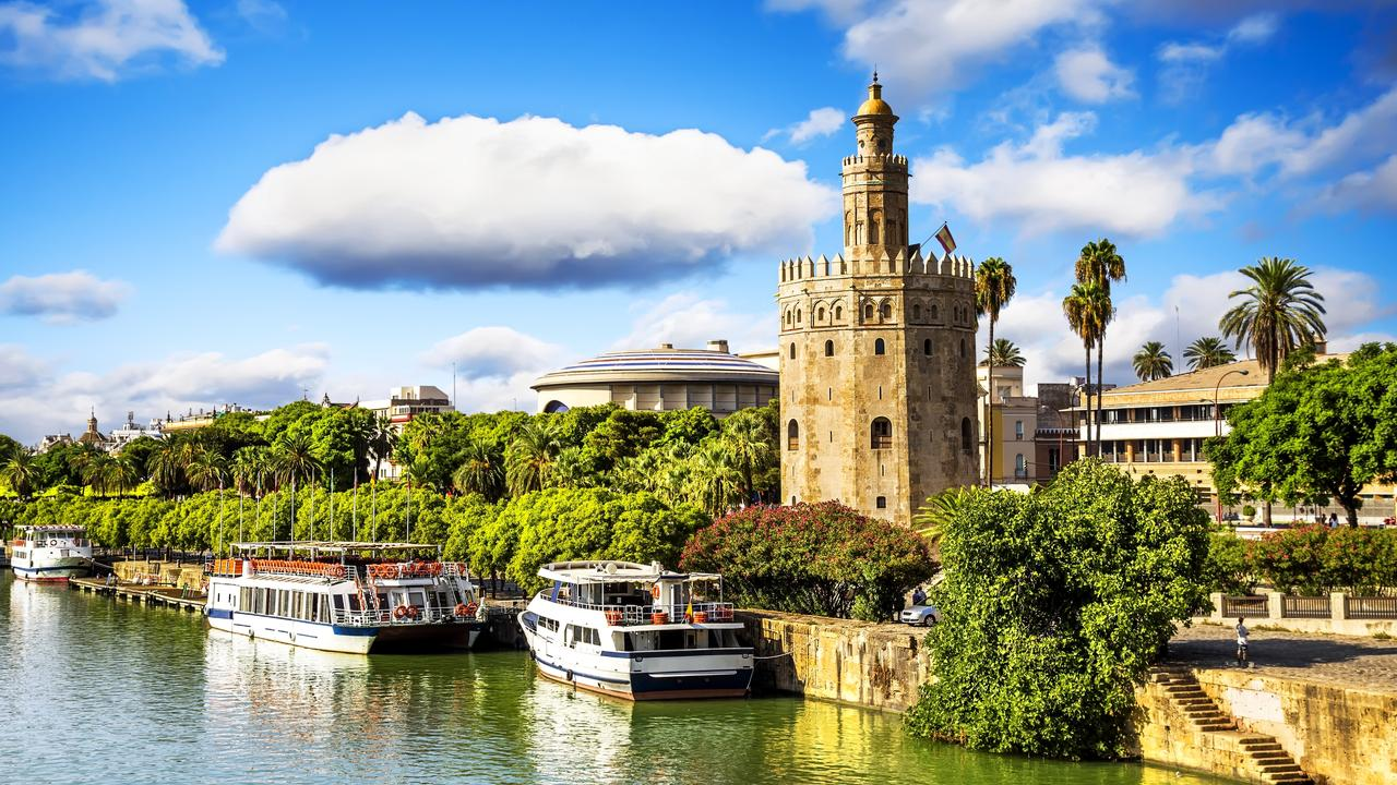 Golden tower (Torre del Oro) along the Guadalquivir river hints at but a sliver of Seville history.