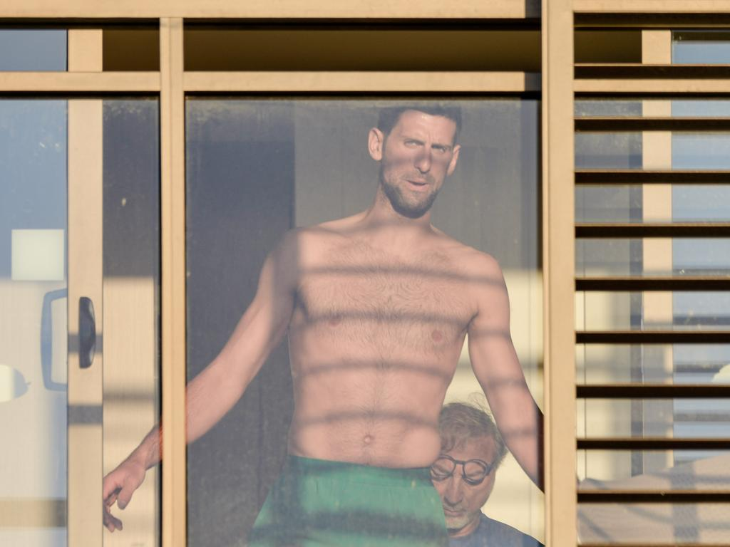 Djokovic training in his hotel during his 14 day isolation.