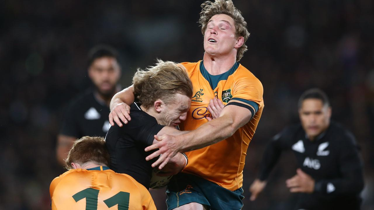 Damian McKenzie clashes with Michael Hooper. Picture: Anthony Au-Yeung/Getty Images