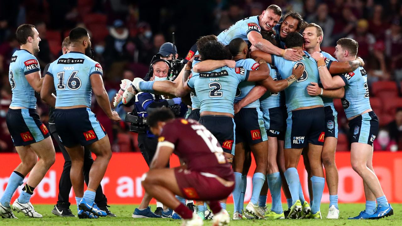 The Blues celebrate and the Maroons commiserate.
