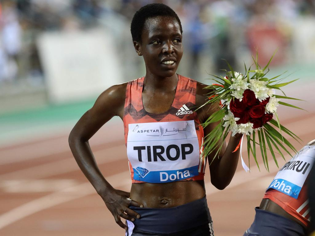 (FILES) In this file photo taken on May 04, 2018 Agnes Jebet Tirop of Kenya celebrates after winning second-place in the women's 3000 metres race during the Diamond League athletics competition at the Suhaim bin Hamad Stadium in Doha. - Record-breaking Kenyan distance runner Agnes Tirop was found dead on October 13, 2021 with stab wounds to her stomach in a suspected homicide, athletics officials said. (Photo by KARIM JAAFAR / AFP)