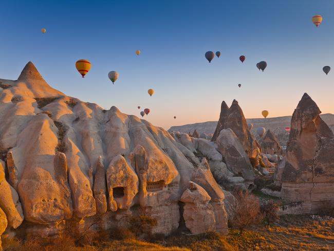 "CAPPADOCIA This semi-arid area of Turkey, is, I promise you, one of the most extraordinary places you'll ever see. Cappadocia is made up of four regions — Nevsehir, Kayseri, Aksaray and Nigde — that are renowned for their ""fairy chimneys"" of tall, cone-shaped rock formations. A hot-air balloon, if you can manage it, is the ultimate way to see this landscape."