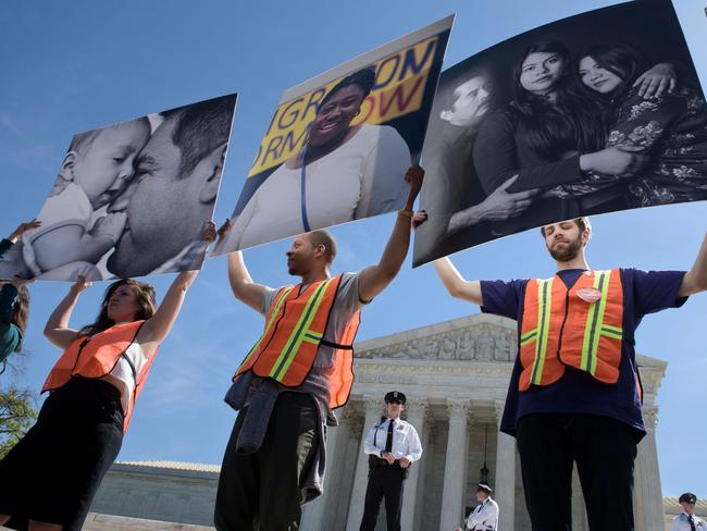 Togetherness ... Supporters of President Obama's immigration reform rally. Picture: AFP/Brendan Smialowski