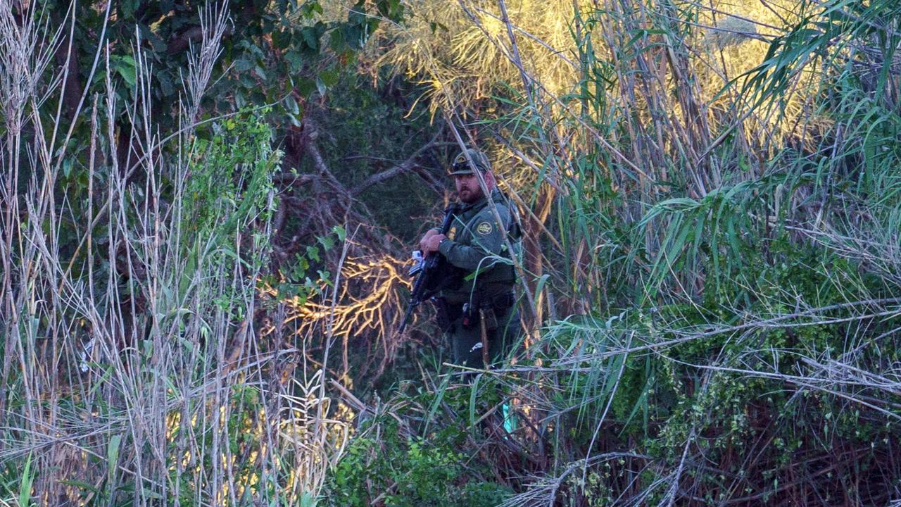 A US Border Patrol agent patrols the US bank of the Rio Grande. Picture: Paul Ratje / AFP