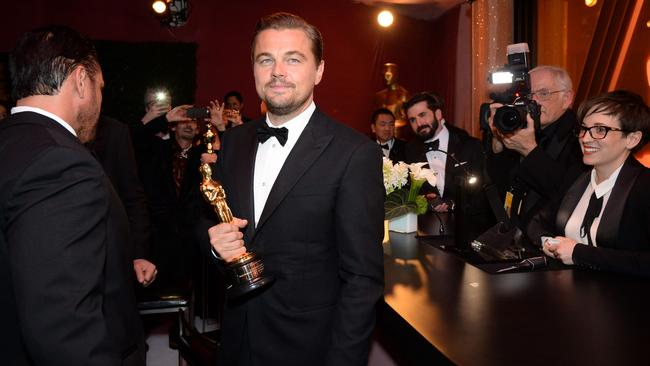 Leonardo DiCaprio poses with his Oscar at the 88th Annual Academy Awards Governors Ball.