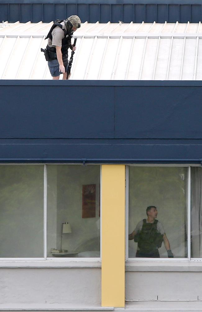 Police were deployed on the roof of the apartment building. Picture: AAP Image/Steve Pohlner