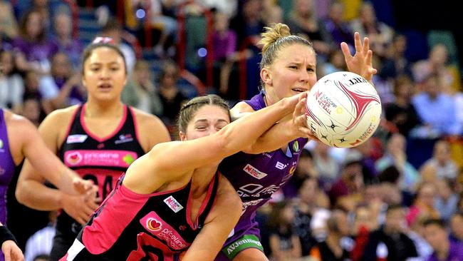 Mahalia Cassidy of the Firebirds and Kaitlyn Bryce of the Thunderbirds battle for possession. Picture: Getty