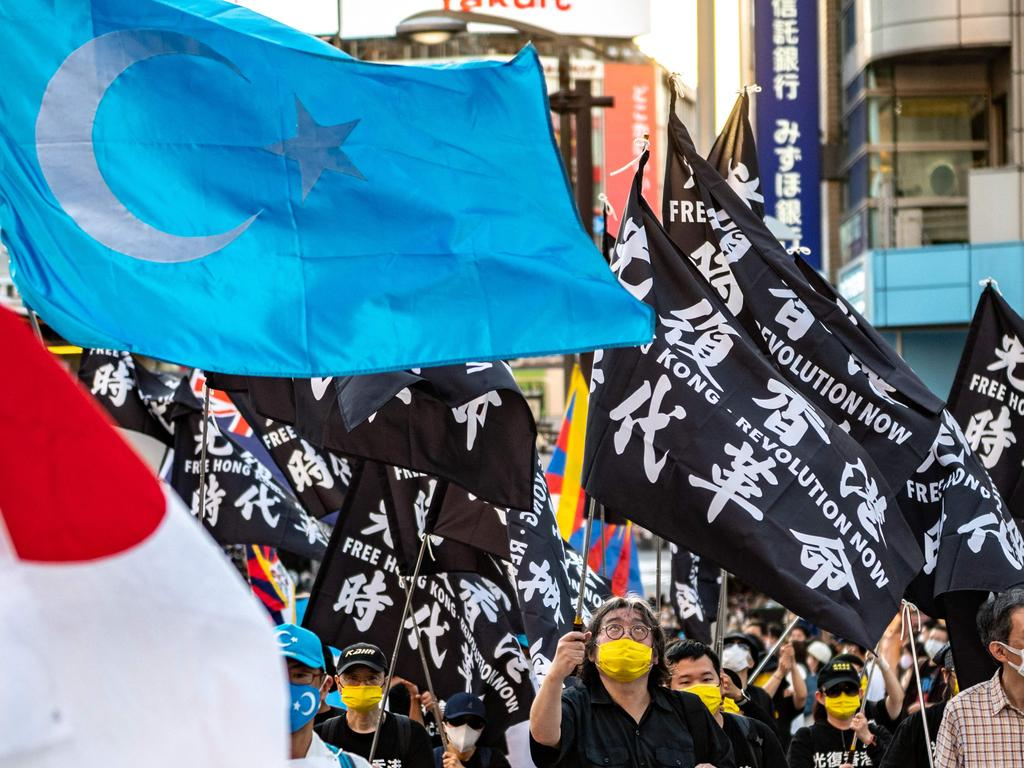 The protesters cited China's treatment of Uyghur Muslims as part of the reason for the boycott. Picture: Philip FONG / AFP.