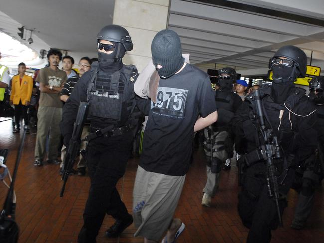 Suspects ... police escort four Turks who were arrested on arrival at Jakarta airport on September 14. The country's anti-terrorism police squad, Detachment 88, arrested the men, along with three Indonesians. Picture: AFP