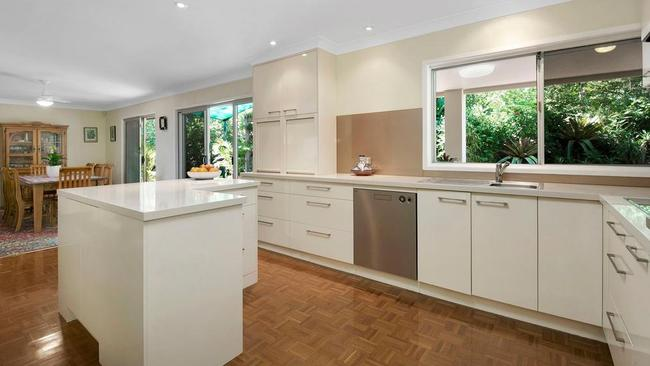 The kitchen is tidy and modern.