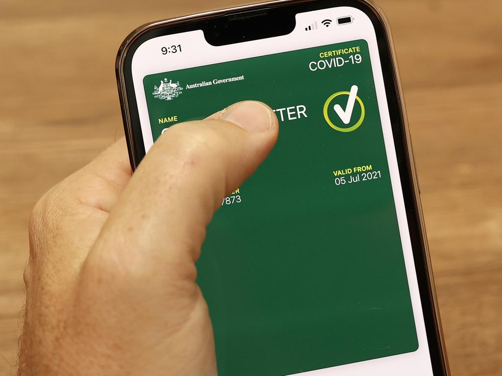 SYDNEY, AUSTRALIA - OCTOBER 14: In this photo illustration a man holds a phone displaying a valid Australian digital COVID-19 certificate on October 14, 2021 in Sydney, Australia. Australians are downloading digital COVID-19 vaccine certificates to prove their vaccination status as restrictions ease for people who are fully vaccinated against the coronavirus. (Photo illustration by Cameron Spencer/Getty Images)