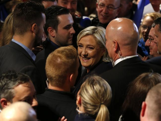 French far-right presidential candidate Marine Le Pen, centre, smiles among supporters at her election day headquarters. Picture: AP Photo/Michel Euler