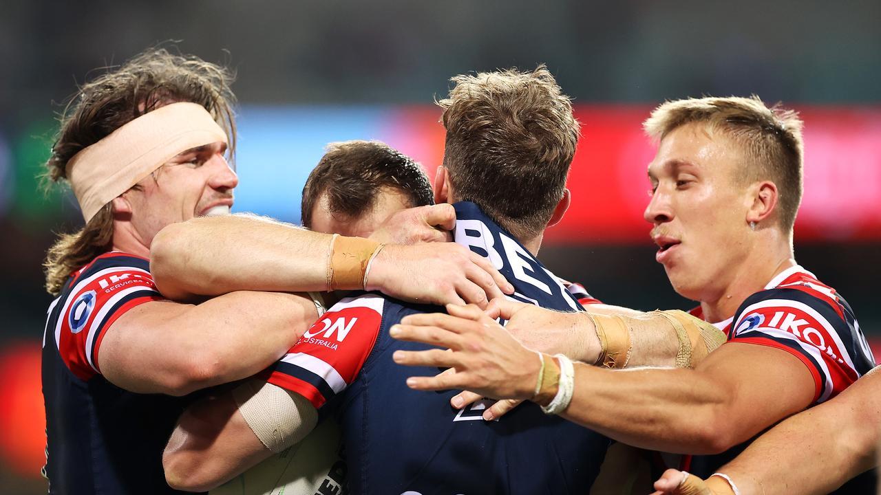 Sam Walker celebrates with his team mates