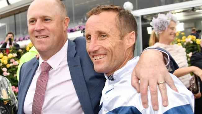 Oliver celebrating with trainer Danny O'Brien. Picture: AAP