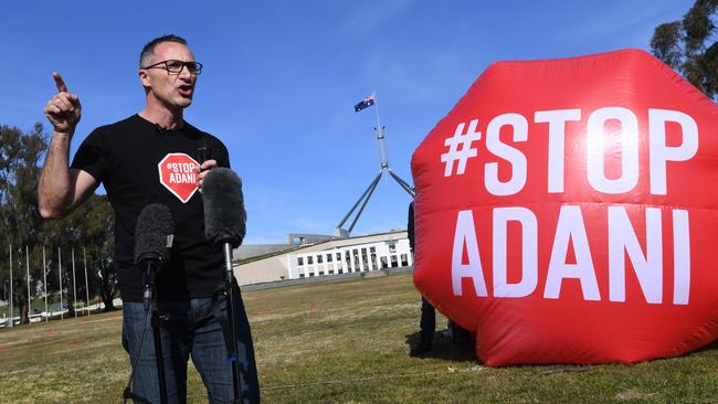 Australian Greens leader Richard di Natale addresses people during a protest against the Adani mine outside Parliament House in Canberra on August 10. Picture: Lukas Coch/AAP