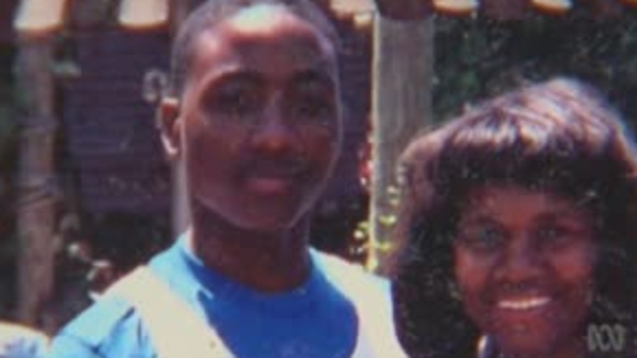 Lamarr Monson with his mother Dolores before his false arrest for the murder of a 12-year-old girl who was bludgeoned to death.