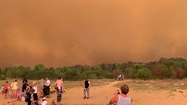 Batemans Bay beach with evacuated residents and tourists