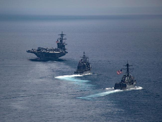 USS Carl Vinson (left) leading the Arleigh Burke-class guided-missile destroyer USS Michael Murphy (centre) and the Ticonderoga-class guided-missile cruiser USS Lake Champlain in the Indian Ocean on April 14, 2017. Picture: Danny Kelley/US Navy/AFP