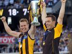 27/09/2008 SPORT: 2008 Grand Final. Geelong v Hawthorn. MCG. Hawthorn captain Sam Mitchell and coach Alastair Clarkson hold aloft the premiership cup.