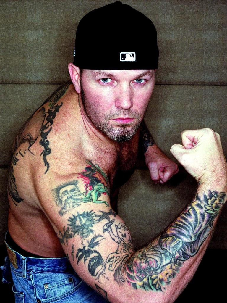 Durst shows off his tattoos in 2003...
