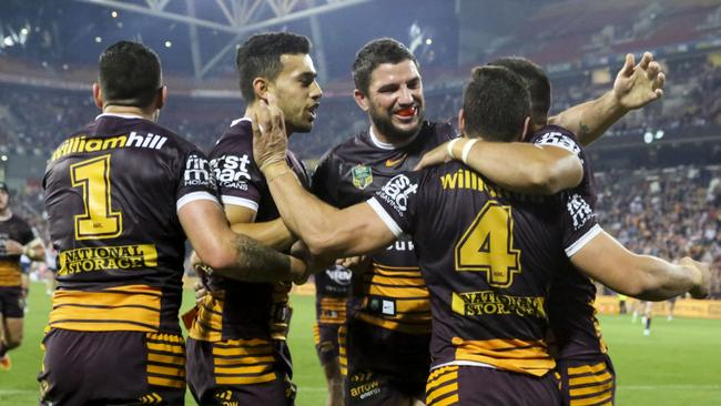 Broncos celebrate a James Roberts try against the Roosters.