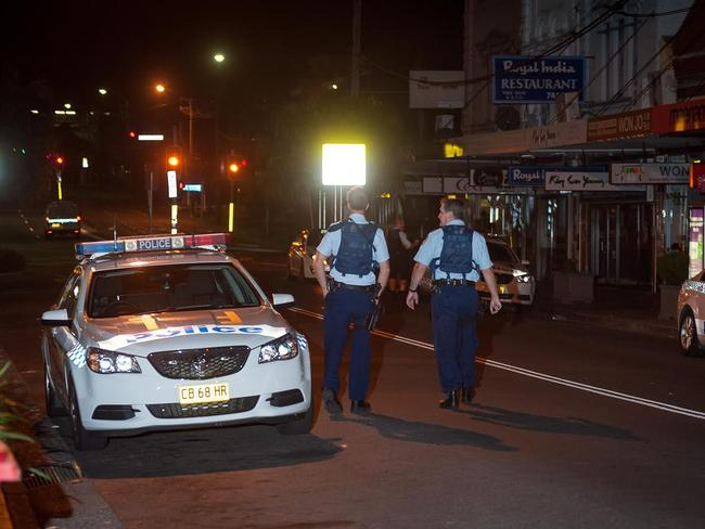 Officers patrol the area after the incident. Picture: Steve Harris