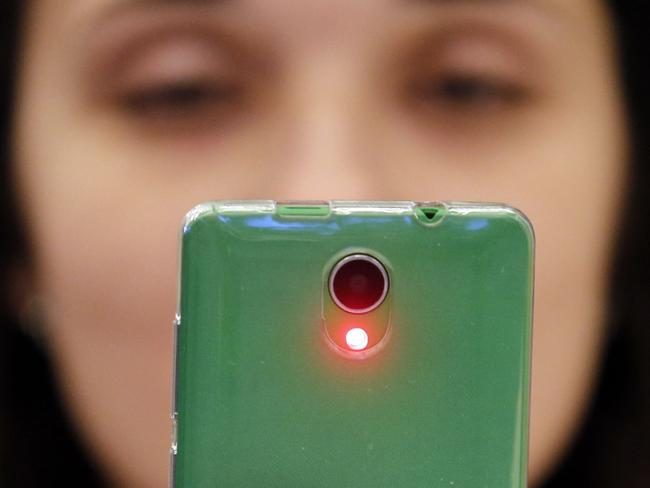Your smartphone could be causing your bad moods. Picture: AFP Photo/Maxim Zmeyev