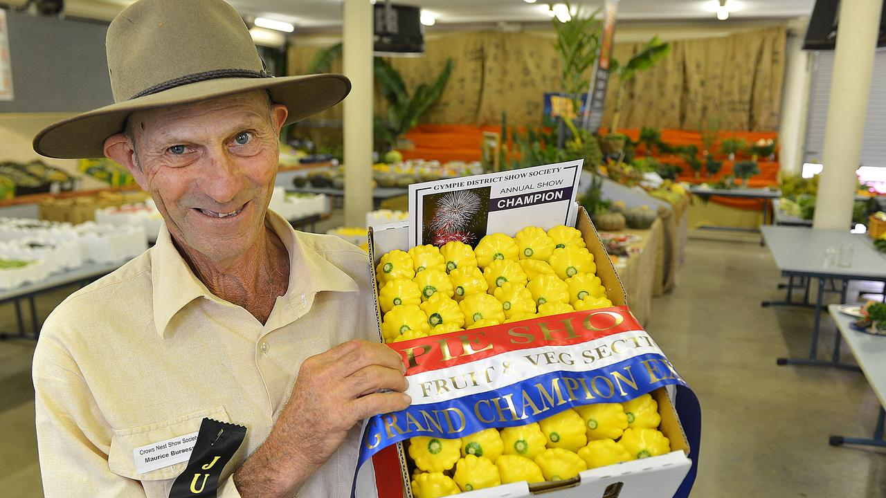 Gympie Show Fruit and Veg judge Maurice Burgess with champion Fruit and Veg. File photo.