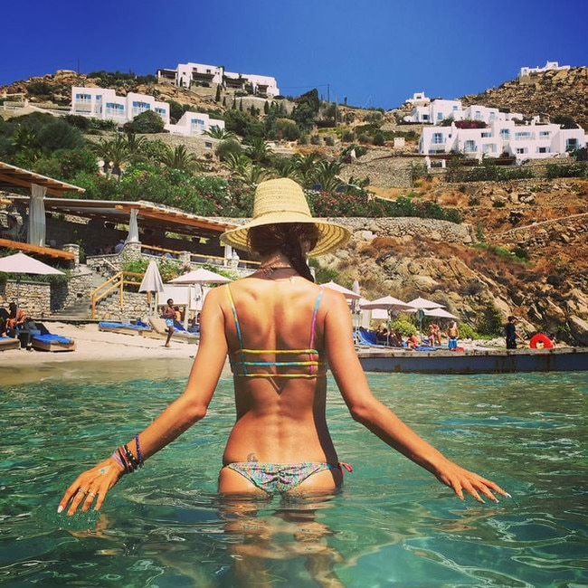 Be sure to pack an array of bikini's to compliment your holiday glow ... Where: Santa Marina Resort Villas,a Luxury Collection Hotel in Mykonos Picture: @alessandraambrosio/Instagram