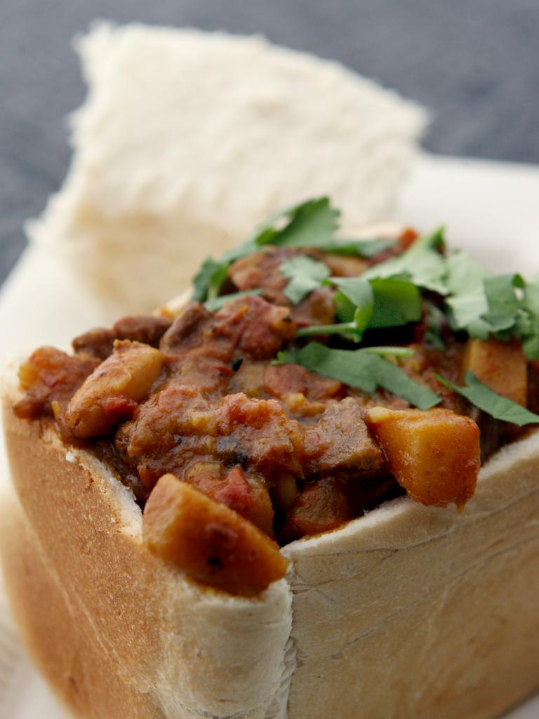 Bunny chow: Indian-South African curry served in bread. Picture: Mark Calleja